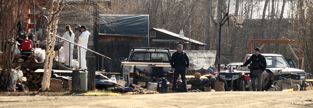 """Investigators work at the scene of the fatal shooting of Alaska State Trooper Sergeant Patrick """"Scott"""" Johnson and Trooper Gabriel """"Gabe"""" Rich Friday, May 2, 2014, in the villa ..."""