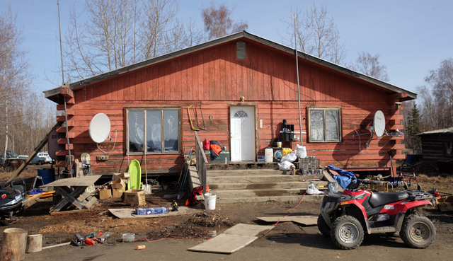 """This Friday, May 2, 2014 photo shows the house at the scene of the fatal shooting of Alaska State Trooper Sergeant Patrick """"Scott"""" Johnson and Trooper Gabriel """"Gabe"""" Rich in th ..."""