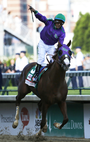 Victor Espinoza rides California Chrome to victory during the 140th running of the Kentucky Derby horse race at Churchill Downs Saturday, May 3, 2014, in Louisville, Ky. (AP Photo/Tim Donnelly)
