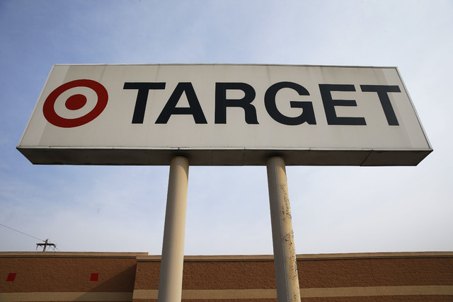 In this Tuesday, March 25, 2014 photo, a sign outside a Target store in Philadelphia is shown. Target said Monday, May 5, 2014, that Chairman, President and CEO Gregg Steinhafel is out, nearly fiv ...