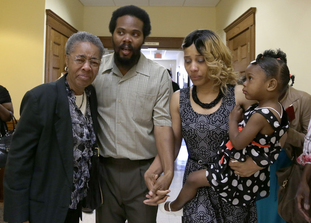 "Cornealious ""Mike"" Anderson walks out of the Mississippi County Courthouse along with his wife, LaQonna Anderson, daughter Nevaeh, 3, and grandmother Mary Porter, left, after being relea ..."
