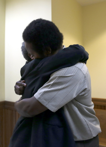 "Cornealious ""Mike"" Anderson, right, gets a hug from his grandmother Mary Porter after being released from custody, Monday, May 5, 2014, in Charleston, Mo. A judge ordered the release of  ..."