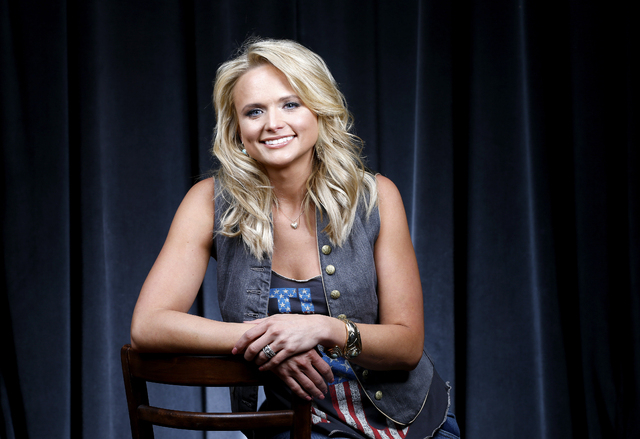 FILE - This Feb. 24, 2014 file photo shows singer Miranda Lambert in Nashville, Tenn. Lambert leads the Country Music Television nominations by pairing up with her husband Blake Shelton, her girl  ...