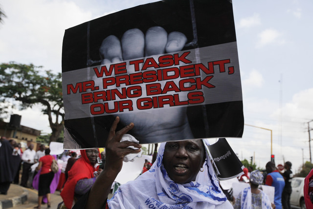 A woman attends a demonstration in Lagos, Nigeria, on Monday, May 5, 2014, urging the government to increase efforts to rescue the hundreds of abducted female students from a government secondary  ...