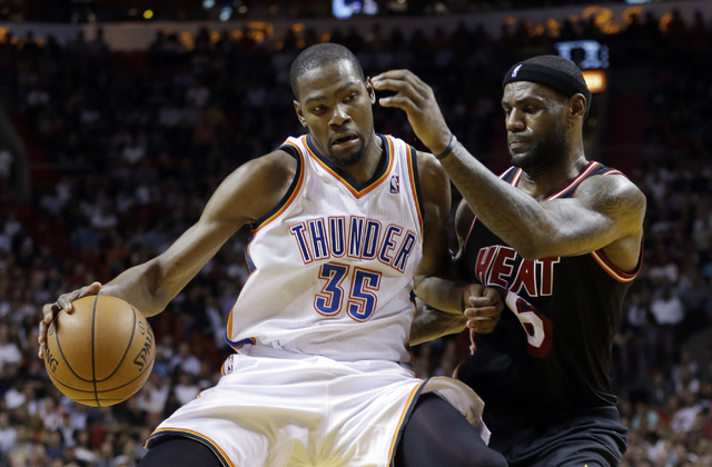 FILE - In this Jan. 29, 2014 file photo, Miami Heat small forward LeBron James (6) puts pressure on Oklahoma City Thunder small forward Kevin Durant (35) during the fourth period of an NBA basketb ...