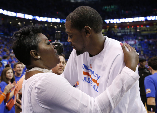 Oklahoma City Thunder forward Kevin Durant, right, hugs his mother, Wanda Pratt, left, following Game 7 of an opening-round NBA basketball playoff series against the Memphis Grizzlies in Oklahoma  ...