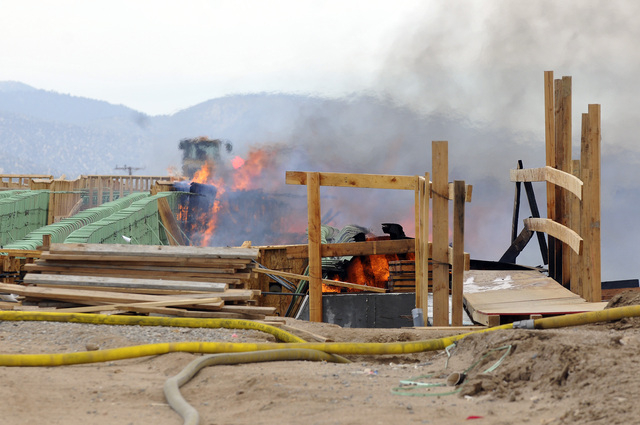 The construction site of the Ranchero Interchange Bridge at Interstate 15 was engulfed in flames on Monday, May 5, 2014, in Hesperia, Calif. The California Highway Patrol's Carlos Juarez says the  ...