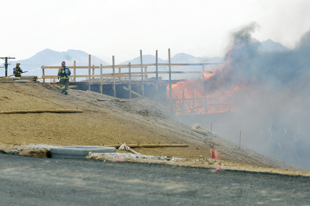 The construction site at Interstate 15 was engulfed in flames on Monday, May 5, 2014, in Hesperia, Calif. The California Highway Patrol's Carlos Juarez says the bridge at Ranchero Road caught fire ...