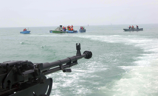 In this file photo taken on April 3, 2006, members of Iran's elite Revolutionary Guard attend  maneuvers in the Persian Gulf. Iran will target American aircraft carriers in the Persian Gulf should ...