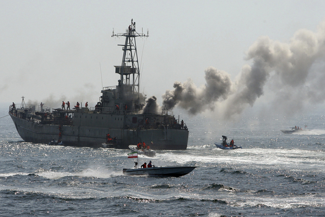 In this file photo taken on  Thursday, April 22, 2010, and released by the semi-official Iranian Fars News Agency, Revolutionary Guard's troops attack and take over a war ship, being used as a tar ...