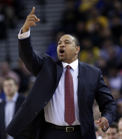 FILE - In this Thursday, Feb. 6, 2014, Golden State Warriors head coach Mark Jackson instructs his team during the first half of an NBA basketball game against the Chicago Bulls in Oakland, Calif. ...