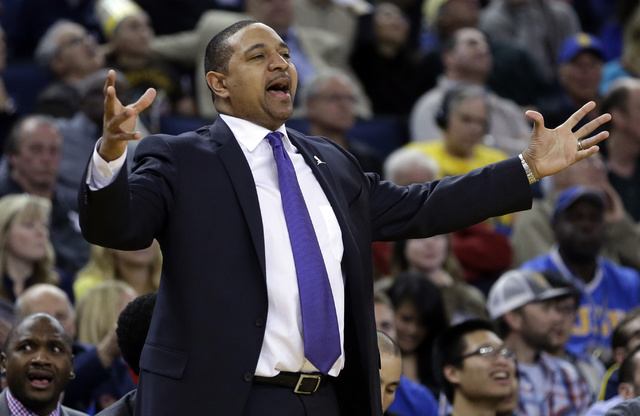 FILE - In this Friday, March 7, 2014, file photo, Golden State Warriors coach Mark Jackson gestures from the sideline during the second half of an NBA basketball game against the Atlanta Hawks in  ...