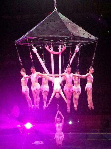 In this photo provided by Frank Caprio, performers hang during an aerial hair-hanging stunt at the Ringling Brothers and Barnum and Bailey Circus, Friday, May 2, 2014, in Providence, R.I. A platfo ...