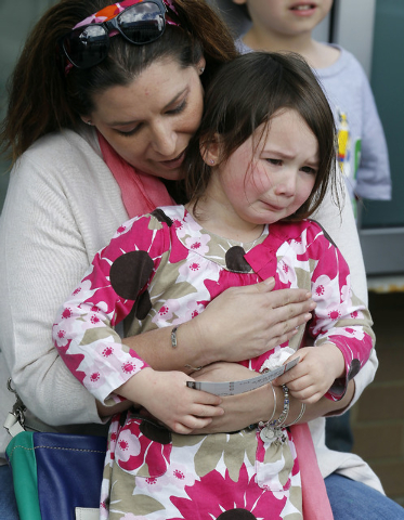 Stacey Tracy, of Cranston, R.I., comforts her daughter Emily Tracy, 4, after she found out the 3:00 p.m. show of the Ringling Bros. and Barnum & Bailey Circus had been canceled, Sunday, May 4, 201 ...