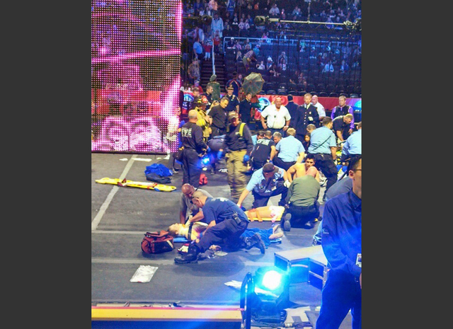 In this photo provided by Rosa Viveiros, first responders work at the center ring after a platform collapsed during an aerial hair-hanging stunt at the Ringling Brothers and Barnum and Bailey Circ ...