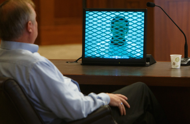In this March 27, 2014, file photo, Lorin Holm, an exiled member of the Fundamentalist Church of Jesus Christ of Latter Day Saints, looks on as video of a deposition of FLDS Church leader Warren J ...