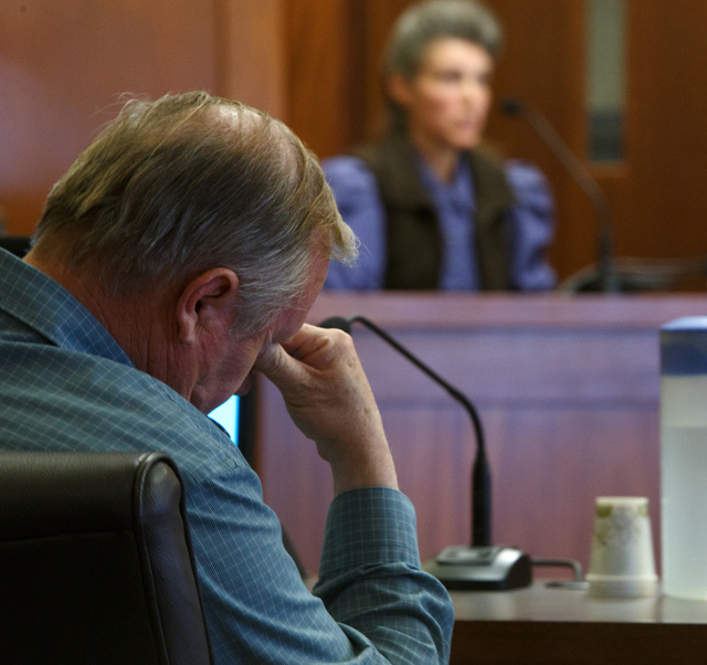 In this March 25, 2014, file photo, Lorin Holm, left, rubs his eyes as his ex-wife, Lynda Peine testifies in 5th District Court in St. George, Utah, during a hearing in which Holm is seeking custo ...