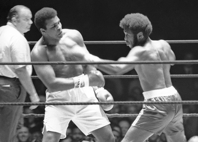 FILE - In this July 27, 1971, file photo, Referee Jay Edson, left, keeps an eye on the fight between Muhammad Ali and Jimmy Ellis, right, in the 12th round of their heavyweight fight in Houston. E ...