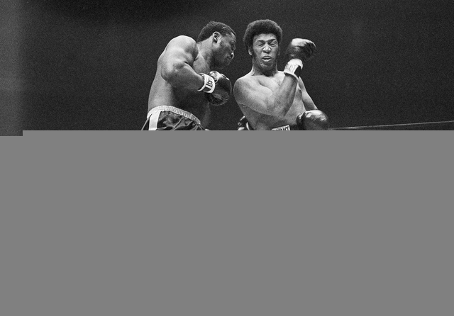 FILE - In this Feb. 16, 1970, file photo, Joe Frazier connects to the body of Jimmy Ellis who misses with a right during the first round of their heavyweight title bout at Madison Square Garden in ...
