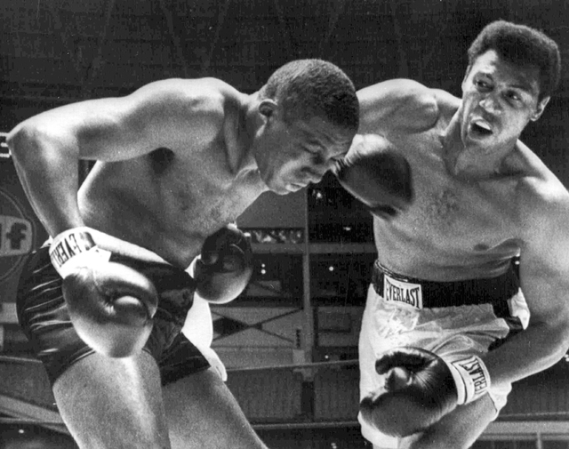 FILE - In this Aug. 5, 1967, file photo, Jimmy Ellis, right, lands a right hook to the head  Leotis Martin during their 12-round World Heavyweight title elimination fight in Houston, Texas. Ellis, ...