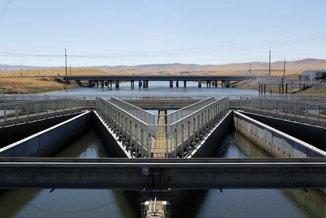 In this Sept. 23, 2013 file photo, water flows through fish diversion louvres at the John E. Skinner Delta Fish Protective Facility from the Clifton Court Forebay on its way to the Harvey O. Banks ...
