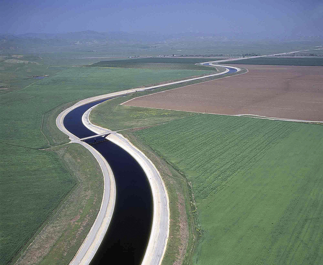 This undated file photo released by the California Department of Water Resources shows water making its way south through the Central Valley by way of the California Aqueduct. The California Aqued ...
