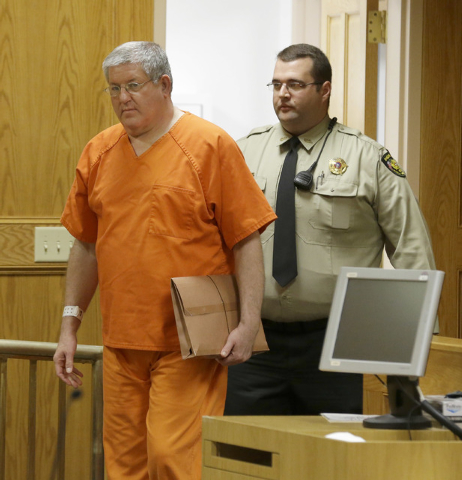 Bernie Tiede walks into a court before a hearing granting his release at the Panola County court house in Carthage, Texas, Tuesday, May 6, 2014.  The former mortician whose killing of a rich widow ...