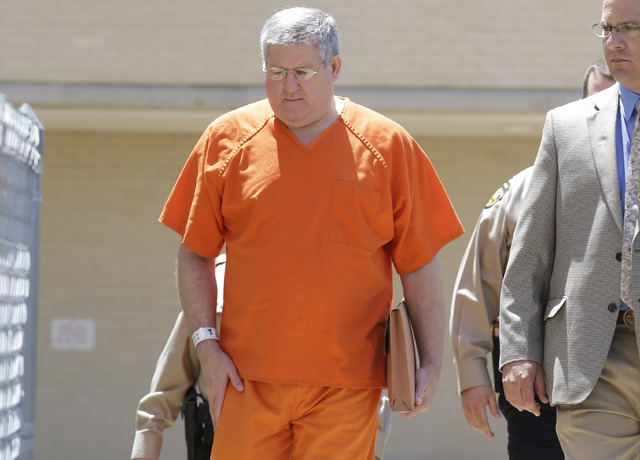 Bernie Tiede is led into the Panola County court house by law enforcement officials in Carthage, Texas, Tuesday, May 6, 2014. The former mortician serving a life sentence for the death of a rich E ...