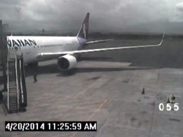 This April 20, 2014 image taken from a surveillance video provided by the Hawaii Department of Transportation, shows a California teen, left, after hopping from a jet's wheel well in Maui, Hawaii. ...
