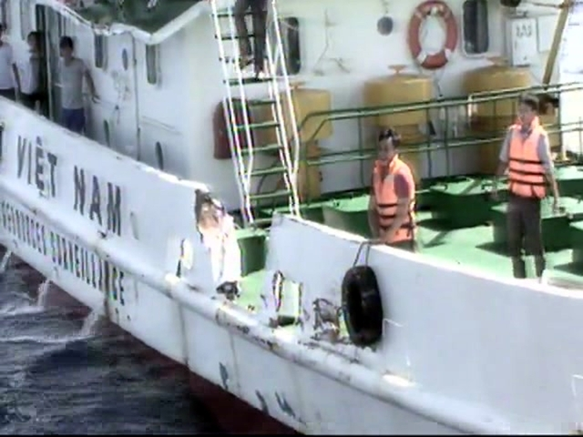 In this video image released by Vietnam Coast Guard, Vietnamese surveillance ship crew members stand near the side of the ship, allegedly damaged after being rammed by a Chinese ship, in the South ...
