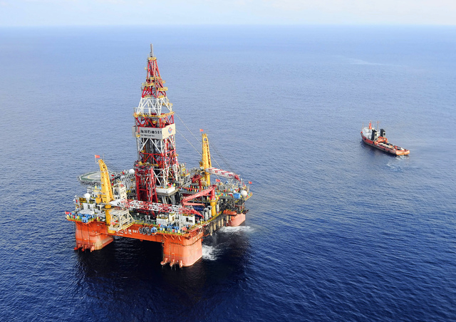 In this May 7, 2012 file photo released by China's Xinhua News Agency, CNOOC 981, the first deep-water drilling rig developed in China, is pictured at 320 kilometers (200 miles) southeast of Hong  ...