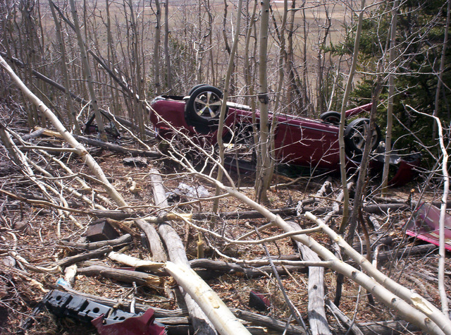 In this May 2014, photo provided by the Park County Sheriffs Office, Kristin Hopkins' car is seen after she drove off the roadway near the old mining town of Fairplay, Colo., sometime after she wa ...