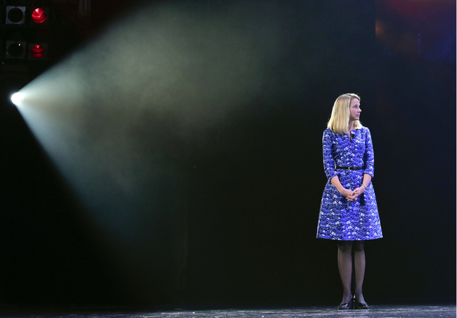 FILE - In this Tuesday, Jan. 7, 2014, photo, Yahoo president and CEO Marissa Mayer speaks during a keynote address at the International Consumer Electronics Show, in Las Vegas. Mayer will face a $ ...