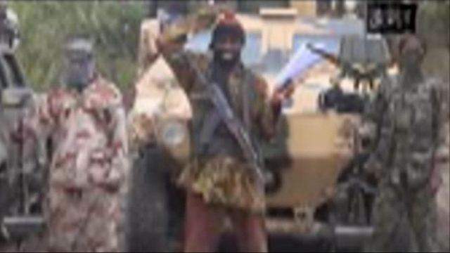 In this file image made from video received by The Associated Press on Monday, May 5, 2014, Abubakar Shekau, the leader of Nigeria's Islamic extremist group Boko Haram, speaks in a video in which  ...