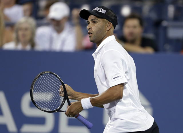 FILE - In this Aug. 28, 2013 file photo, James Blake reacts during a first round match against Ivo Karlovic, of Croatia, at the U.S. Open tennis tournament in New York.  Officials say firefighters ...