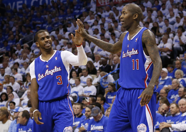 Los Angeles Clippers guard Chris Paul (3) high fives teammate Jamal Crawford (11) in the second quarter of Game 2 of the Western Conference semifinal NBA basketball playoff series against the Okla ...