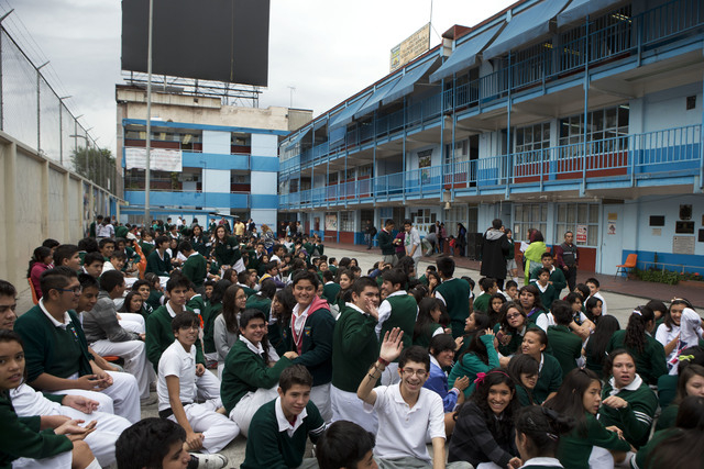 Students gather in the courtyard of their school after an earthquake shook Mexico City, Thursday, May 8, 2014. A strong earthquake in southern Guerrero state shook the southern Pacific coast of Me ...