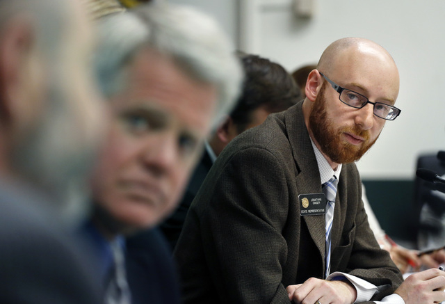 Rep. Jonathan Singer, D-Longmont, listens to discussion on a bill he sponsored which would allow marijuana dispensaries to form financial co-operatives, at the Colorado Legislature, in Denver, Wed ...