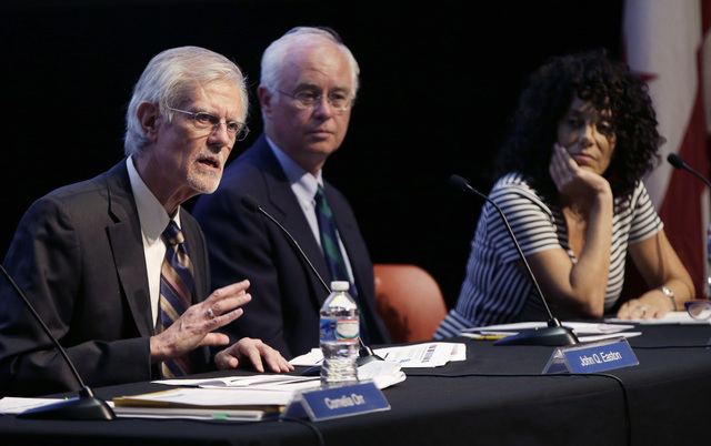 From left, John Easton, Director of the Institute of Education Sciences and Acting Commissioner of the National Center for Education Statistics, Dale Nowlin, a 12th-grade mathematics teacher at Ba ...