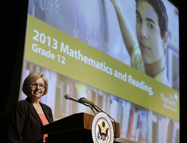 Cornelia Orr, Executive Director, National Assessment Governing Board pauses before she begins a program at Dunbar High School, Wednesday, May 7, 2014, in Washington, to announce results of The Na ...