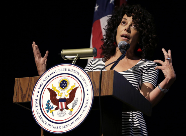 Susan Pimentel, an educational consultant and curriculum specialist and Vice Chair of the National Assessment Governing Board gestures as she speaks during a program at Dunbar High School, Wednesd ...