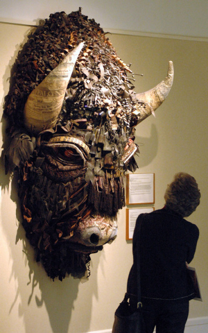 FILE - This Jan. 27, 2006 file photo shows a woman looking at Buffalo, a mixed media piece by artist Holly Hughes, part of the Capitol Art Collection at the Capitol in Santa Fe, N.M. The collectio ...