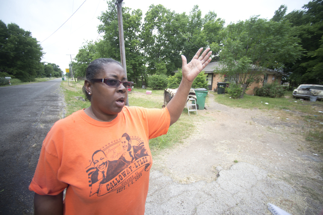 Johnnie Demeritt, 55, who was neighbors and friends with Pearlie Golden, 93, talks to the media on Wednesday, May 7, 2014, in Hearne, Texas. Police in Central Texas say an officer fatally shot Gol ...