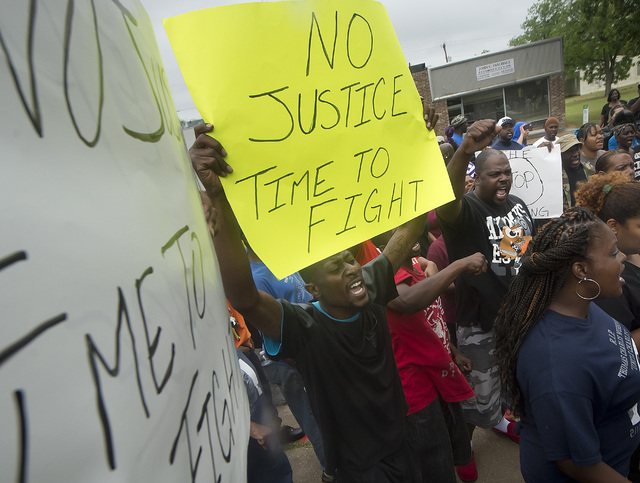 Protesters chant during a rally outside the Hearne, Texas police department Thursday, May 8, 2014 following the Tuesday shooting of 93-year-old woman.  Robertson County District Attorney Coty Sieg ...