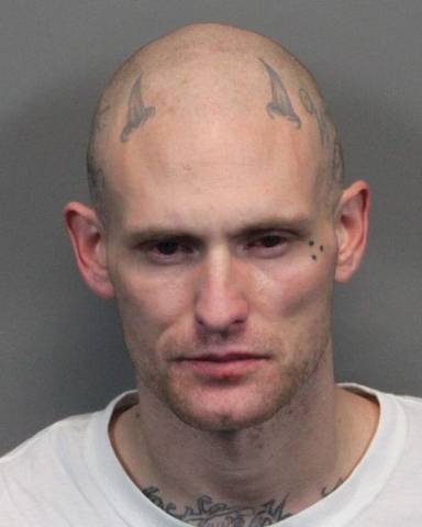 This June 11, 2013 image provided by the Washoe County Sheriff's Office shows Alex. C. Snelson, a Nevada inmate who says he practices Satanism and has accused county jailers of violating his const ...