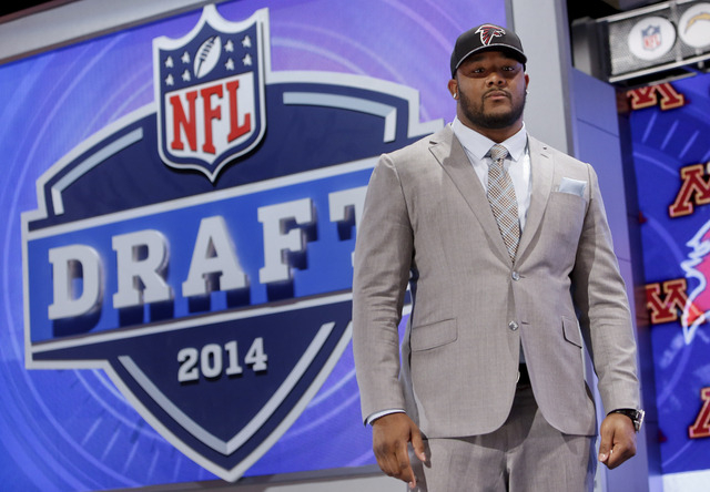 Minnesota defensive tackle Ra'Shede Hageman poses for photos after being selected by the Atlanta Falcons as the 37th pick during the second round of the 2014 NFL Draft, Friday, May 9, 2014, in New ...
