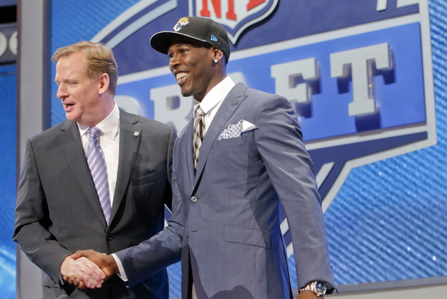 USC wide receiver Marqise Lee, right is greeted by NFL commissioner Roger Goodell  after being selected as the 39th pick by the Jacksonville Jaguars in the second round of the 2014 NFL Draft, Frid ...