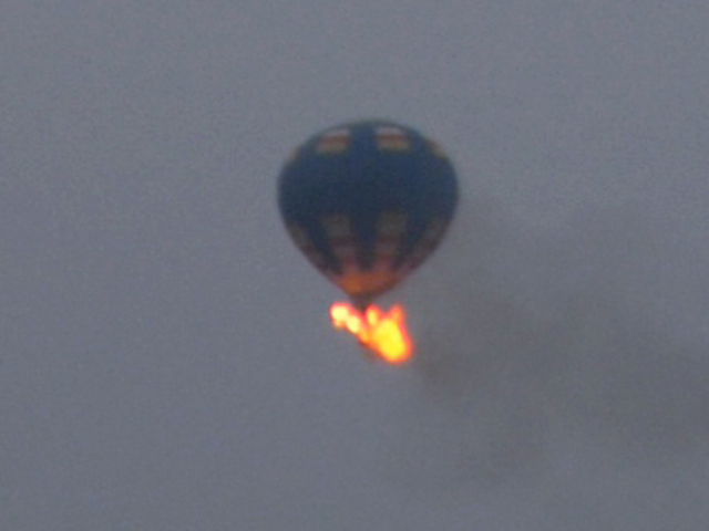 This photo provided by Nancy Johnson shows what authorities say is a hot-air balloon that was believed to have caught fire and crashed in Virginia, Friday, May 9, 2014. Virginia State Police recei ...