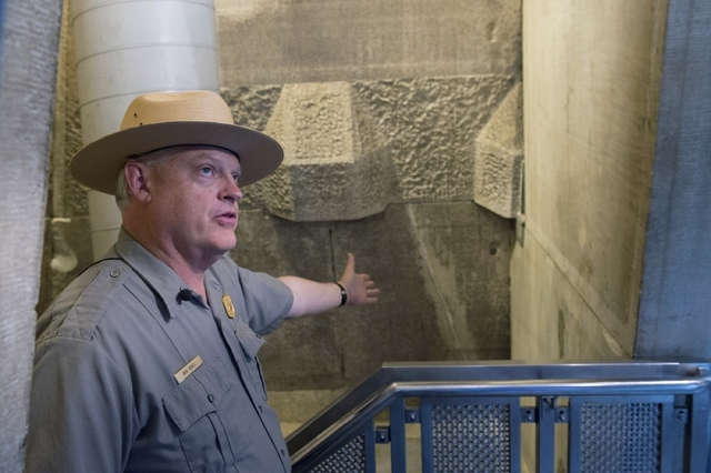 Bob Vogel, superintendent of National Mall and Memorial Parks, points out a repaired crack inside the Washington Monument on Saturday, May 10, 2014, prior to the reopening of the monument, in Wash ...