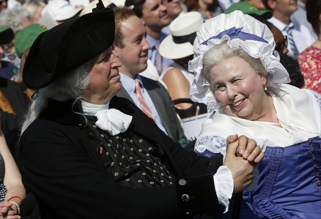 George Washington played by Dean Malissa, left, and Martha Washington played by Mary Wiseman, attend a ceremony to celebrate the reopening of the Washington Monument on Monday, May 12, 2014, in Wa ...